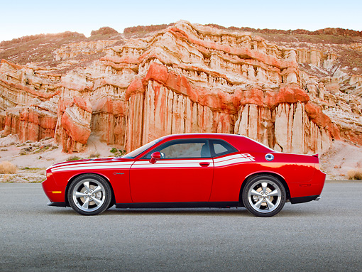 AUT 46 RK0080 01 © Kimball Stock 2011 Dodge Challenger Red Profile View On Pavement By Red Rock