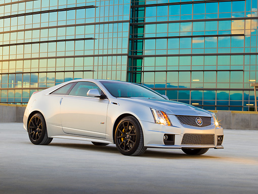 AUT 46 RK0088 01 © Kimball Stock 2011 Cadillac CTS V Silver 3/4 Front View On Pavement By Glass Building