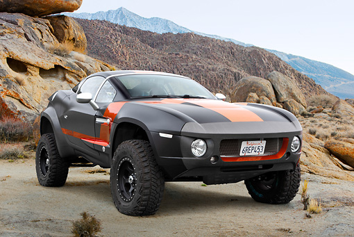 AUT 46 RK0120 01 © Kimball Stock 2011 Local Motors Rally Fighter Black With Orange Stripe 3/4 Front View On Dirt In Desert