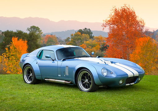 AUT 46 RK0127 01 © Kimball Stock 2011 Brock Daytona Coupe Blue With White Stripe 3/4 Front View On Grass By Autumn Trees