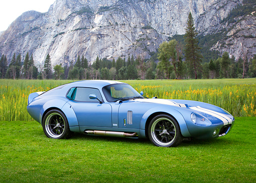 AUT 46 RK0129 01 © Kimball Stock 2011 Brock Daytona Coupe Blue With White Stripe 3/4 Side View On Grass By Mountain