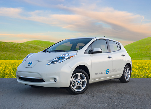 AUT 48 BK0008 01 © Kimball Stock 2012 Nissan Leaf White 3/4 Front View On Pavement By Grassy Hills
