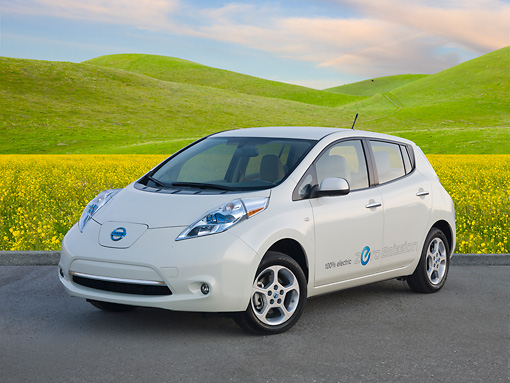 AUT 48 BK0009 01 © Kimball Stock 2012 Nissan Leaf White 3/4 Front View On Pavement By Grassy Hills