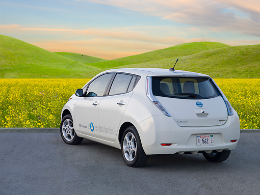 AUT 48 BK0010 01 © Kimball Stock 2012 Nissan Leaf White 3/4 Rear View On Pavement By Grassy Hills