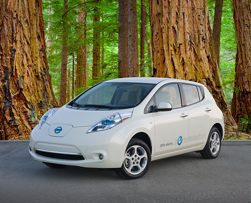 AUT 48 BK0011 01 © Kimball Stock 2012 Nissan Leaf White 3/4 Front View On Pavement By Redwood Trees