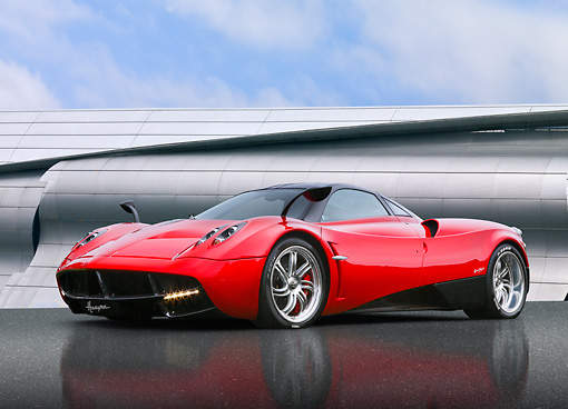 AUT 48 BK0015 01 © Kimball Stock 2012 Pagani Huayra Red 3/4 Front View On Concrete By Metal Structure