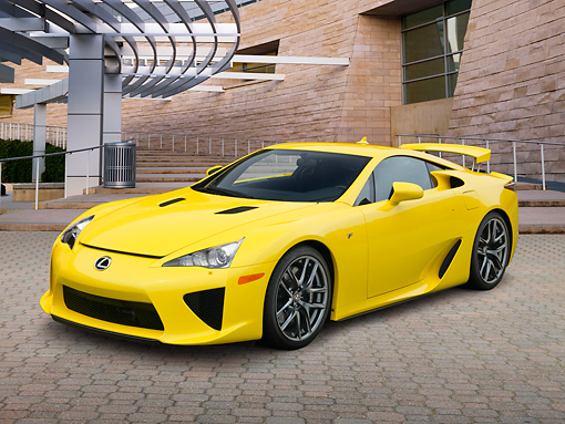 AUT 48 RK0004 01 © Kimball Stock 2012 Lexus LFA Coupe Yellow 3/4 Front View On Brick By Building