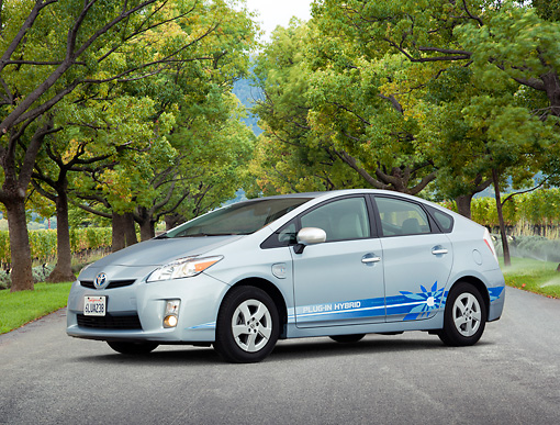 AUT 48 RK0021 01 © Kimball Stock 2012 Toyota Prius Plug-In Hybrid Blue 3/4 Front View On Pavement By Autumn Trees