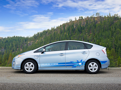AUT 48 RK0023 01 © Kimball Stock 2012 Toyota Prius Plug-In Hybrid Blue Profile View On Pavement By Mountains