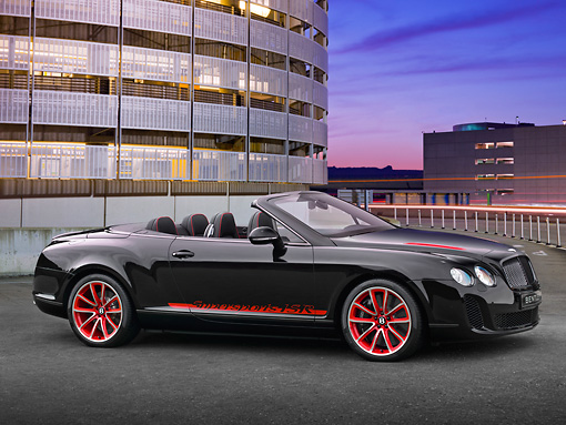 AUT 48 RK0029 01 © Kimball Stock 2012 Bentley Continental Supersports ISR Convertible Black And Red 3/4 Side View In Parking Garage At Night