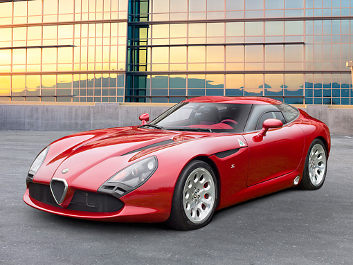 AUT 48 RK0035 01 © Kimball Stock 2012 Alfa Romeo TZ3 Stradale Red 3/4 Front View On Concrete By Glass Building
