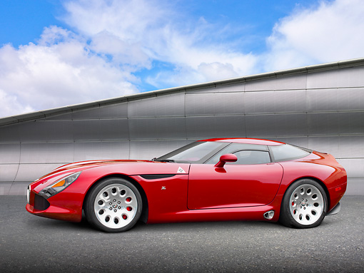 AUT 48 RK0037 01 © Kimball Stock 2012 Alfa Romeo TZ3 Stradale Red Profile View On Pavement By Metal Structure