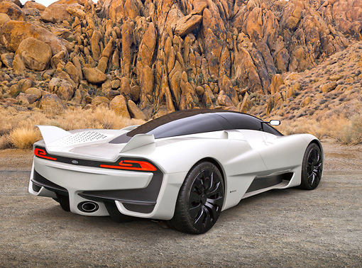 AUT 48 RK0041 01 © Kimball Stock 2012 Shelby SSC Tuatara Next Generation Supercar White 3/4 Rear View On Gravel By Red Rock