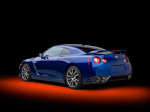 AUT 48 RK0047 01 © Kimball Stock 2012 Nissan GT-R Deep Blue Pearl 3/4 Rear View In Studio