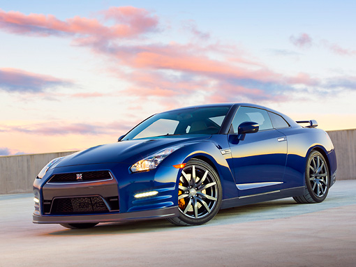 AUT 48 RK0052 01 © Kimball Stock 2012 Nissan GT-R Deep Blue Pearl 3/4 Front View On Concrete At Dusk