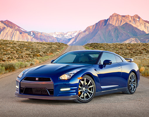 AUT 48 RK0054 01 © Kimball Stock 2012 Nissan GT-R Deep Blue Pearl 3/4 Front View On Pavement By Mountains