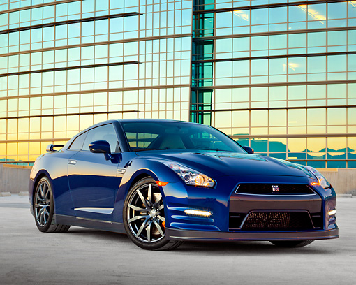 AUT 48 RK0055 01 © Kimball Stock 2012 Nissan GT-R Deep Blue Pearl 3/4 Front View On Concrete By Glass Building At Dusk