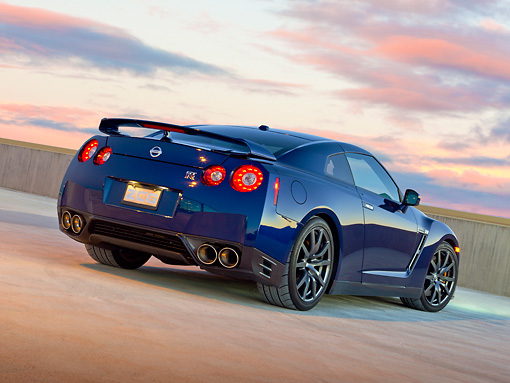 AUT 48 RK0056 01 © Kimball Stock 2012 Nissan GT-R Deep Blue Pearl 3/4 Rear View On Concrete At Dusk