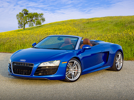 AUT 48 RK0073 01 © Kimball Stock 2012 Audi R8 Spyder Blue 3/4 Front View On Pavement By Meadow
