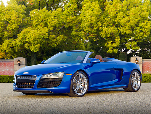 AUT 48 RK0075 01 © Kimball Stock 2012 Audi R8 Spyder Blue 3/4 Front View On Pavement By Trees
