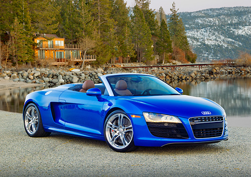 AUT 48 RK0076 01 © Kimball Stock 2012 Audi R8 Spyder Blue 3/4 Front View On Pavement By Lake And Cabin