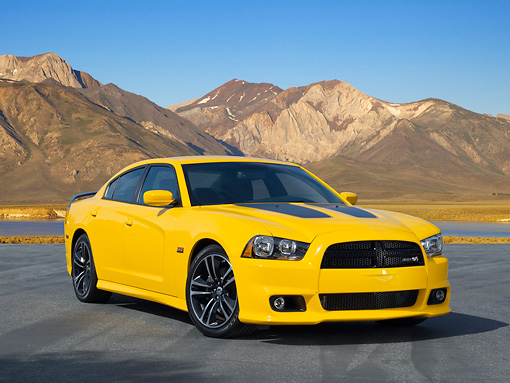 AUT 48 RK0082 01 © Kimball Stock 2012 Dodge Charger SRT 8 Yellow 3/4 Front View On Pavement By Mountains