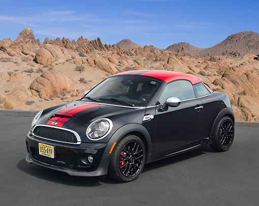 AUT 48 RK0085 01 © Kimball Stock 2012 Mini John Cooper Works Black With Red Top 3/4 Front View On Pavement In Desert
