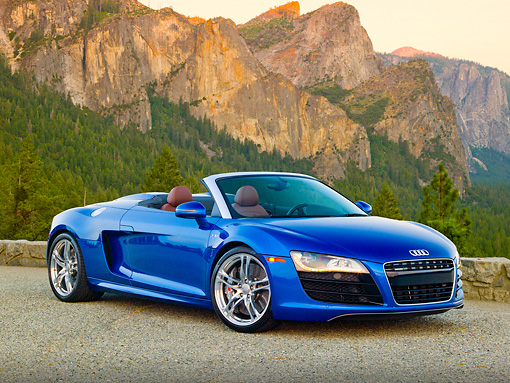 AUT 48 RK0103 01 © Kimball Stock 2012 Audi R8 Spyder Blue 3/4 Front View On Pavement By Mountains