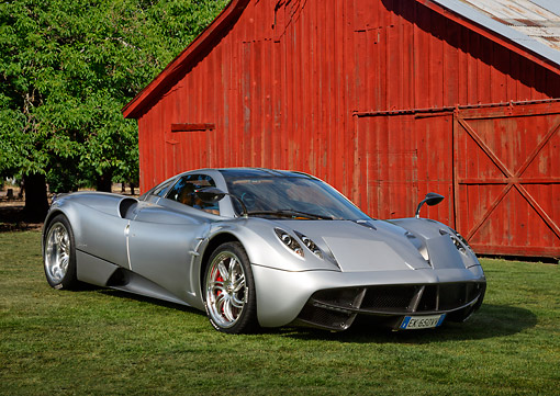 AUT 48 RK0104 01 © Kimball Stock 2012 Pagani Huayra Silver 3/4 Front View On Grass By Barn