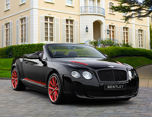 AUT 48 RK0106 01 © Kimball Stock 2012 Bentley Continental Supersports ISR Convertible Black And Red 3/4 Front View On Brick By Mansion
