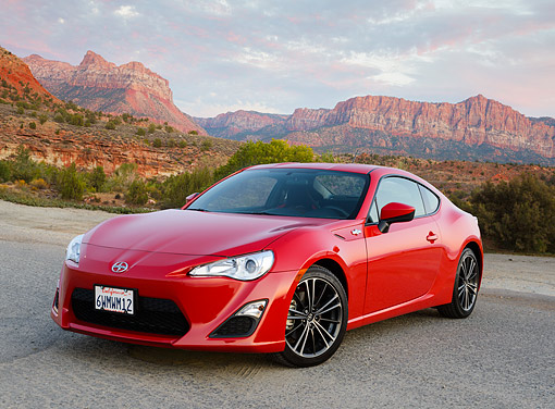AUT 49 RK0017 01 © Kimball Stock 2013 Scion FR-S Red 3/4 Front View On Pavement In Desert