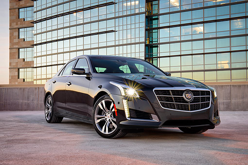 AUT 50 BK0003 01 © Kimball Stock 2014 Cadillac CTS Black 3/4 Front View On Pavement By Glass Building At Dusk