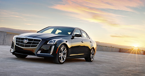 AUT 50 BK0004 01 © Kimball Stock 2014 Cadillac CTS Black 3/4 Front View On Concrete At Sunset