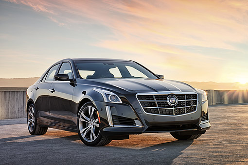 AUT 50 BK0006 01 © Kimball Stock 2014 Cadillac CTS Black 3/4 Front View On Concrete At Sunset