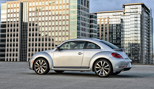 AUT 50 BK0010 01 © Kimball Stock 2014 Volkswagen Beetle Silver Profile View On Concrete By Glass Buildings