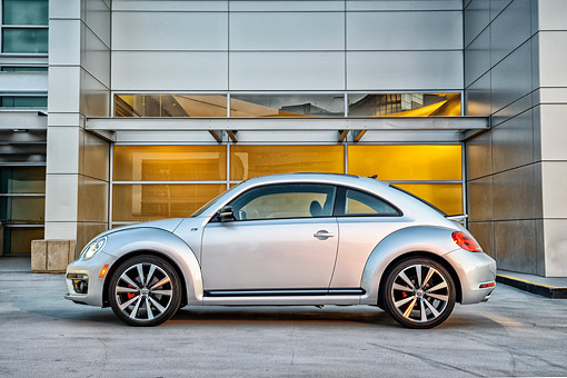 AUT 50 BK0012 01 © Kimball Stock 2014 Volkswagen Beetle Silver Profile View On Concrete By Glass Building