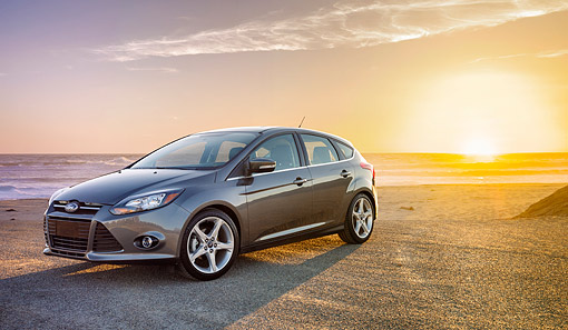 AUT 50 BK0019 01 © Kimball Stock 2014 Ford Focus Titanium Gray 3/4 Front View On Beach At Sunset