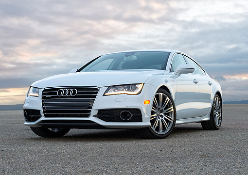 AUT 50 BK0026 01 © Kimball Stock 2014 Audi A7 White Low 3/4 Front View On Pavement In Evening Under Clouds