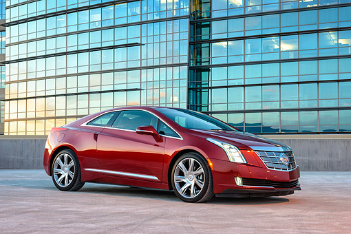AUT 50 RK0033 01 © Kimball Stock 2014 Cadillac ELR Luxury Plug-In Hybrid 3/4 Front View Under City Building
