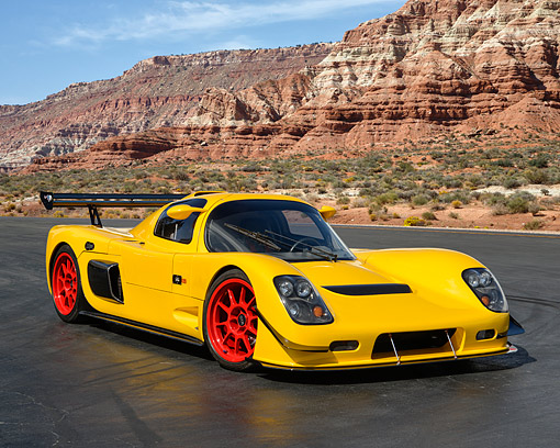 AUT 50 RK0035 01 © Kimball Stock 2014 Ultima GTR Yellow 3/4 Front View On Pavement In Desert