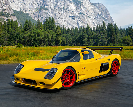 AUT 50 RK0037 01 © Kimball Stock 2014 Ultima GTR Yellow 3/4 Front View On Pavement In Forest