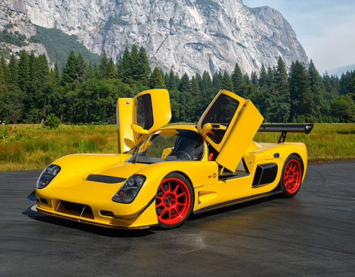 AUT 50 RK0038 01 © Kimball Stock 2014 Ultima GTR Yellow 3/4 Front View On Pavement In Forest