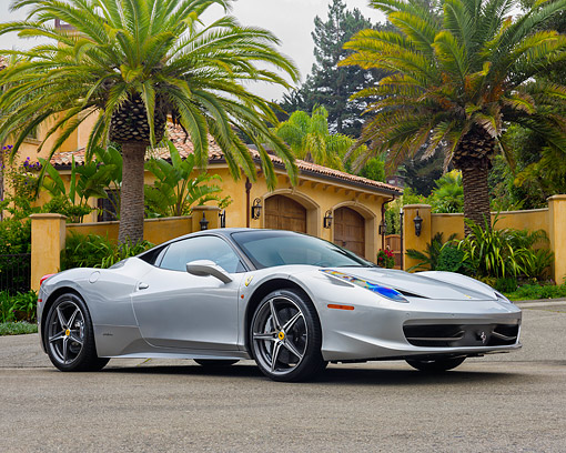 AUT 50 RK0040 01 © Kimball Stock 2014 Ferrari 458 Silver 3/4 Front View On Pavement By House And Palm Tree