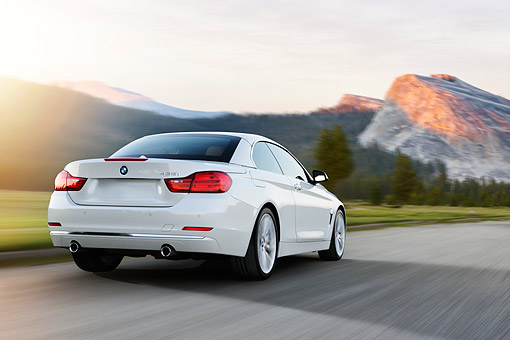 AUT 50 RK0041 01 © Kimball Stock 2014 BMW 435i Convertible White 3/4 Rear View Driving On Road