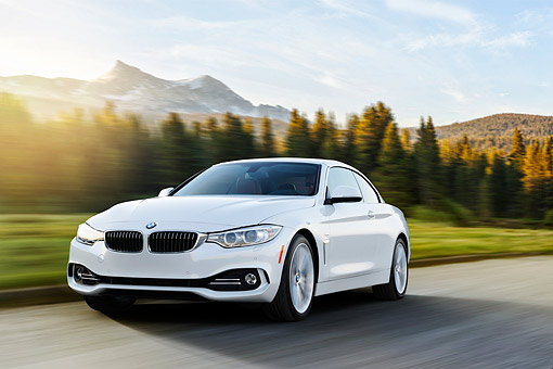 AUT 50 RK0042 01 © Kimball Stock 2014 BMW 435i Convertible White 3/4 Front View Driving On Road