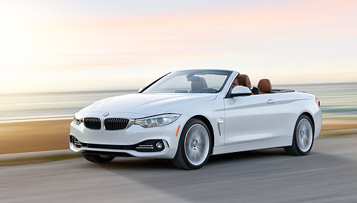 AUT 50 RK0044 01 © Kimball Stock 2014 BMW 435i Convertible White 3/4 Front View Driving On Road