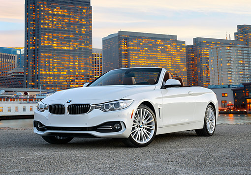 AUT 50 RK0046 01 © Kimball Stock 2014 BMW 435i Convertible White 3/4 Front View On Pavement By City