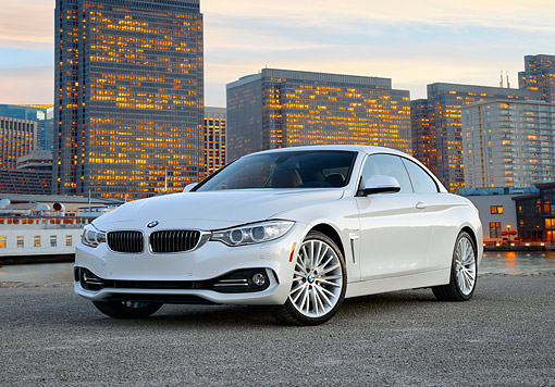 AUT 50 RK0047 01 © Kimball Stock 2014 BMW 435i Convertible White 3/4 Front View On Pavement By City