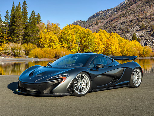 AUT 50 RK0048 01 © Kimball Stock 2014 McLaren P1 3/4 Front View On Pavement By Mountain Lake