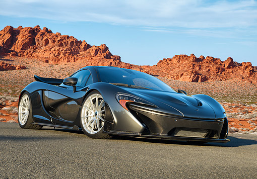 AUT 50 RK0049 01 © Kimball Stock 2014 McLaren P1 3/4 Front View On Pavement In Desert